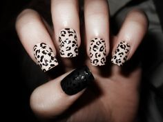 leopard nails with black thumb.