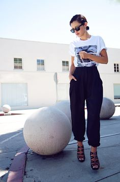 Awesome look on Karla's Closet: slicked back pony and graphic tee tucked into high-waisted, rolled up leg trousers.