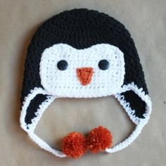 Keep heads warm this winter with an adorable crochet penguin hat! Free pattern included!