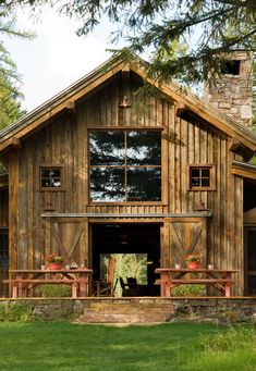 Reclaimed barn wood and timber frame lake house - Swan Valley, Montana. RMT Architects, Denver.