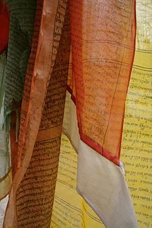 Close-up view of prayer flags. Check Out the Immanuel Prayer Wheel - Maranatha Prayer Community today and assemble with others in praying for our God's soon return, and pray for your needs, and also many other things. Click below for more info!