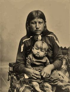 "Osage girl and baby boy - 1906. The OSAGE Nation is a Midwestern Native American Siouan-speaking tribe in the United States who originated in the Ohio River valley in the area of present-day Kentucky. Historically, the Osage were known as Ni-u-kon-ska, considered an ancient name which roughly translates into ""mid-waters."""