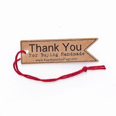 Custom Shop Tags Thank You For Buying Handmade Tags. 50 Flag Shaped Shop Tags with Heart Shaped String Hole. Merchandise Tag etc. (T6). $19.95, via Etsy.