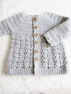 Crochet Baby Girl Textured Crochet Baby Sweater Pattern - Crochet Dreamz - This crochet baby sweater includes 6 sizes from baby to Toddler. The pattern has an easy to work Raglan shaping and a textured body with floral stitches. Crochet Baby Sweater Pattern, Crochet Baby Sweaters, Baby Sweater Patterns, Baby Girl Sweaters, Baby Girl Crochet, Crochet Baby Clothes, Baby Patterns, Crochet Baby Jacket, Crochet Baby Dresses