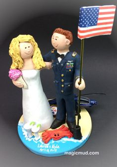 Blackhawk Helicopter Wedding Cake Topper, Pilot's Wedding Cake Topper, Air Force Pilot's Wedding Cake Topper, Old Glory Wedding Cake Topper      Blackhawk Helicopter Pilot Wedding Cake Topper custom created for you!   $235 #magicmud  call 1 800 231 9814 Handmade to your specifications of kiln fired clay by Hunter, Lois and Jupiter Vaughan of www.magicmud.com