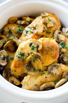 This slow cooker chicken marsala is tender chicken breasts cooked in a mushroom and marsala wine sauce. I always used to order chicken marsala at restaurants, but now that I know how to make it in the crock pot, it's become a dinner time favorite at home too!