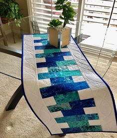 Pretty blues and a beautiful design make this an awesome table runner! https://www.etsy.com/listing/573148216/quilted-table-runnertable?ga_order=most_relevant&ga_search_type=all&ga_view_type=gallery&ga_search_query=quilted%20table%20runners&ref=sc_gallery-4-6&plkey=de9f5955367ce37a0164f426a72e4608ed1c79fe:573148216