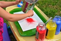 flour sifter + powdered tempera paint + spray bottles = beautiful art (might try with dollar store strainers too!)