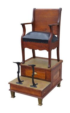Oak shoeshine stand with leather chair and brass detail..I remember one sitting outside the barber shop..