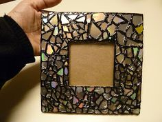 Break up an old CD to create a mosaic frame. #DIY
