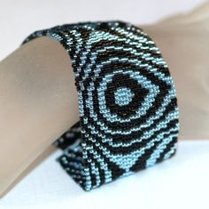 Aqua Raindrops ... Peyote Bracelet . Silver-Lined Beads . Pale Blue . Black . Beadweaving . Wide Cuff . Abstract Design . Concentric