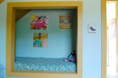 Create a nook in the closet with pillows and books on walls.  farmhouse kids by Corynne Pless