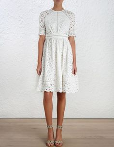 Roza Broderie Day Dress, from our Summer Swim 16 collection, in White floral broderie anglaise. Fitted bodice and waistband, half sleeve and full skirt. Circle insert trim through waistband, sleeve and skirt. Centre back zip closure. Cotton lined through skirt and front of bodice.