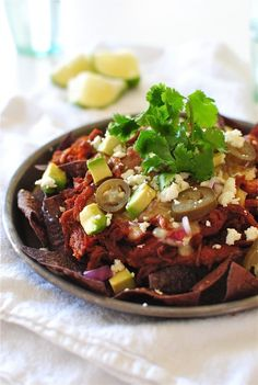 *Slow Cooker BBQ Pork Nachos* * 1 1/2 pound pork loin * 1 cup favorite bbq sauce * 1 white onion, diced * 3 cloves garlic, minced * 1 green bell pepper, diced * blue corn chips * 2 cups shredded pepper jack cheese * finely diced red onion * jarred jalapeno peppers * crumbled cojita cheese * diced avocado * cilantro leaves * lime wedges http://bevcooks.com/2014/03/slow-cooker-bbq-pork-nachos/