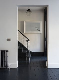dark floors + staircase + vintage radiator