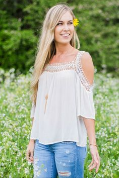 Gorgeous white blouse with shoulder cut outs and detailing around the neckline!