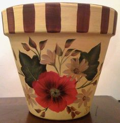 Hand painted clay pot.