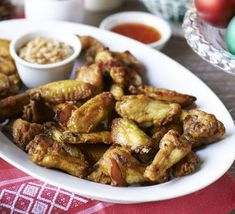 These chicken wings are marinated, then baked until crisp and golden, served with a fiery, crunchy peanut sauce - the ultimate party buffet food
