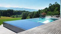 Espectacular piscina de inox desbordante y canal recogida oculto con pavimento de madera