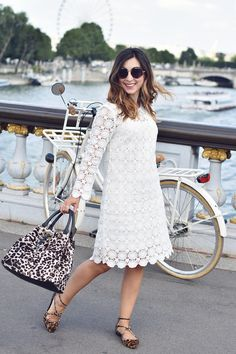 Parisian Blogger @valentinehello in the Floral Lace Dress and leopard print accessories (Bonjour pony skin Strappy Bow Point and Drawstring Bag). Click through to her blog to see how she wears it.