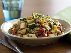 Food Network invites you to try this Toasted Israeli Couscous Salad with Grilled Summer Vegetables recipe from Bobby Flay.