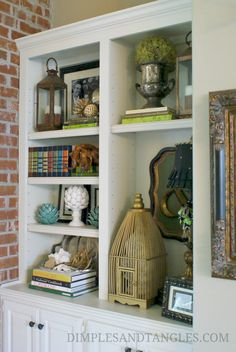 How to decorate your bookshelves.  Mix in a few pretty and personal items with your books.  Remember, it's all in the details!