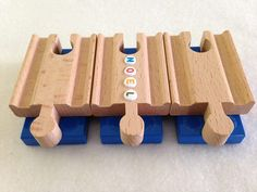 Brio Duplo wooden train track adapters with letter beads. woodpeckers.ch