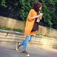 Mustard  Yellow shirt with brown scarf on blue jeans