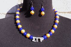 Royal Blue and Gold GREEK Single Strand Pearl Necklace & Earring Set by CreativeTypeOGirl on Etsy https://www.etsy.com/listing/236182831/royal-blue-and-gold-greek-single-strand