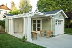 Here, an attached pergola functions as an extension of the garage, rather than above the door. By defining this patio area, the pergola creates the effect of an outdoor room. Design Garage, Carport Designs, House Design, Carport Ideas, Carport Plans, Studio Design, Detached Garage Designs, Cottage Design, Pergola Designs