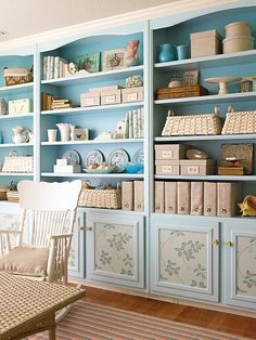 Use wallpaper inserts trimmed with molding to dress up bland or dated cabinet fronts. To update a boring built-in, first apply colorful paint. Next add flair to the cabinet fronts by attaching decorative wallpaper in coordinating colors. Finish by framing the wallpaper inserts with painted molding and adding new hardware.