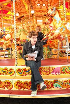 Andrew Garfield on a carousel. <3