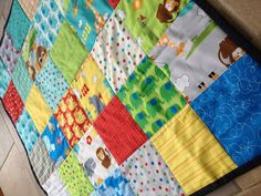 Baby quilt or playmat made with a moda charm pack... Quick, easy and effective!