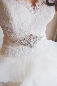 Lace bodice and belt. Lazaro. Photography: Christine Farah Photography - christinefarah.com  Read More: http://www.stylemepretty.com/2014/07/08/glamorous-affair-at-the-london-west-hollywood/