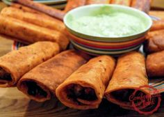 Crispy Chicken Flautas with Avocado Crema - perfect fiesta finger food.