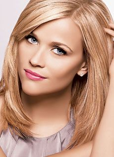 Reese Witherspoon. Slight side bangs, face framing layers, shoulder length hair