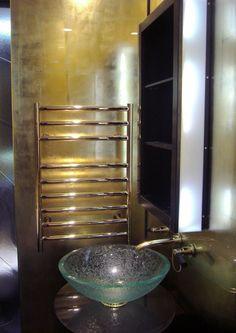 DecoGild luxury glass splashback created using a distressed gilding technique.