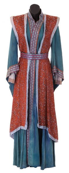 "[Mira Furlan ""Delenn"" costume created for Babylon 5. (Warner Bros. TV, 1994-1998)] Whoever set the costume on the mannequin fastened the belt wrong (it goes under the tabard, not around it *g*) but otherwise what a FANTASTIC--and unusually high-res--reference photo of this costume! #Babylon5 #cosplay"