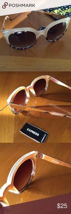 Express Cream and Brown Sunglasses /New Beautiful Express cream and brown with gold accents, 100% UV protection and it comes with draw string bag to keep them clean Express Accessories Sunglasses