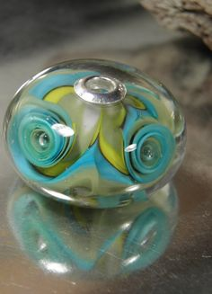 Aqua and Yellow Wave Swirl Bead by RASPBERRYRINGS on Etsy, £18.00