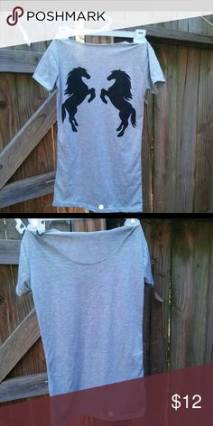 Grey horse shirt Grey shirt with two black horses on the back. Size xs Purchased two but the second I ordered was t small.  I cut the collar off because it felt like it was choking me.. Plus gives it a better look :] Tops Tees - Short Sleeve
