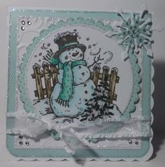 Serendipity Stamps snowman coloured with Copics and lots of glitter! snowflake created from Marianne Design die cuts