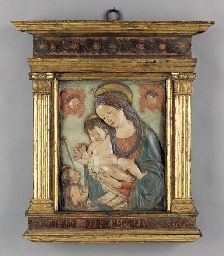 AN ITALIAN RENAISSANCE POLYCHROME-DECORATED TERRACOTTA RELIEF OF THE MADONNA AND CHILD WITH ST. JOHN THE BAPTIST