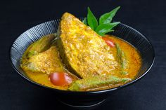 A fiery Malaysian Indian Fish Curry made with tamarind paste, spicy chilli, curry leaves and coconut milk that gives it a traditional Indian twist! Try this Malaysian recipe.