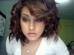 this is how I learned to curl hair with flat iron..SOO simple and CUTE! I do it a few times a week