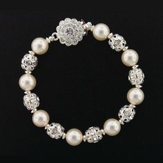 """Beautifully detailed pearl & filigree bracelets, made with Swarovski components.  Available in 7"""", 8"""" or 9""""."""