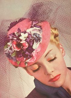 A breathtaking mini straw tilt hat with veiling and millinery flowers. #1930s #1940s #hats