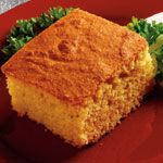 Golden Corn Bread on Clabbergirl.com. Because yr Dad threw away the baking powder can with the recipe. WTF. Also, mix dry stuff, cut shortening in like pie crust, stir in egg and milk.