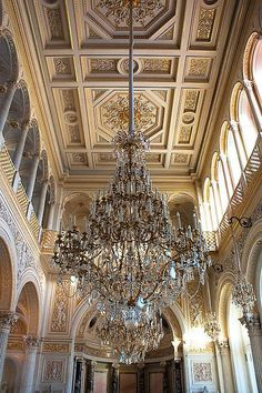 Chandelier in a grand, ornate hall.