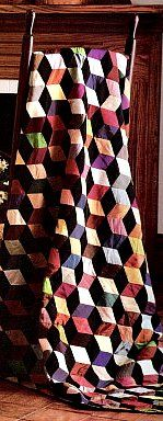 10 Steps to Make a Tumbling Block Quilt - looks complicated, but is supposedly easy to make